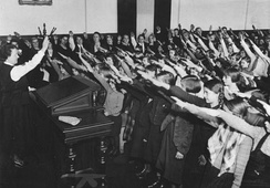 The Nazi salute in school (1934): children were indoctrinated at an early age.