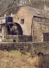 A mid-19th-century water wheel at Cromford in England used for grinding locally mined barytes.
