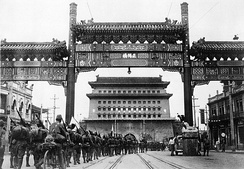 The Japanese occupation of Peiping (Beijing) in China, on August 13, 1937. Japanese troops are shown passing from Peiping into the Tartar City through Zhengyangmen, the main gate leading onward to the palaces in the Forbidden City.