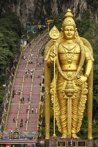 Statue of the Hindu God of War, Murugan, holding his primary weapon, the Vel. - located in the Batu Caves, Malaysia.