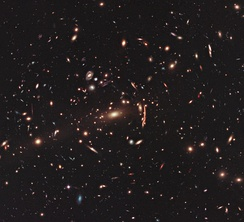 This image from the NASA/ESA Hubble Space Telescope shows the galaxy cluster MACS J1206.