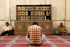 Men reading the Quran at the Umayyad Mosque, Damascus, Syria
