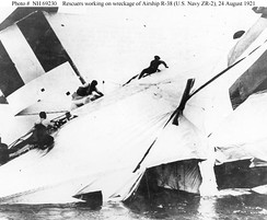 Rescuers scramble across the wreckage of British R-38/USN ZR-2, 24 August 1921.