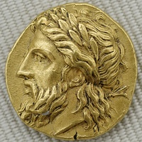 Zeus, the king of the gods in ancient Greek religion, shown on a gold stater from Lampsacus (c. 360–340 BCE)