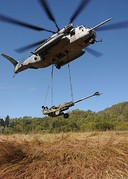 Sea Stallion helicopter lifts an M777