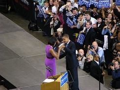 Michelle and Barack Obama fist bump with Michelle in a dress by Pinto