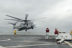 A CH-53E Sea Stallion helicopter assigned to the 24th Marine Expeditionary Unit, lands on the flight deck of the amphibious transport dock ship USS Mesa Verde. It is underway in preparation to support humanitarian assistance and disaster relief efforts in Haiti in response to Hurricane Matthew
