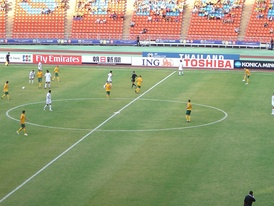 Iraq playing against Australia in Group A of the 2007 AFC Asian Cup; Iraq won the game 3–1 on their way to winning the cup.