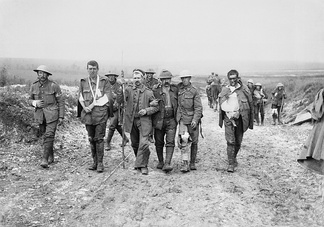 British and German wounded, Bernafay Wood, 19 July 1916. Photo by Ernest Brooks.