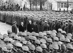 Konrad Adenauer, Theodor Blank, Adolf Heusinger and Hans Speidel inspect formations of the newly created Bundeswehr on 20 January 1955