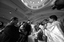 Priest reading the blessing at a Catholic wedding, 2018