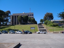 Science Building atop Cloud Hill as viewed from Ram Plaza (the Quad); a CCSF police car patrols along Cloud Circle.