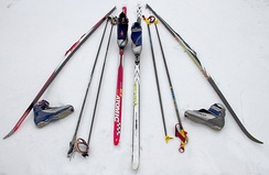 "Cross-country ski equipment for skate-skiing (left) and classic-style skiing (right). Ski and pole lengths are different for each. Classic skis have a ""grip zone"" in the area under the binding."