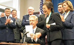 Davis signs AB 574 on September 11, 2003, establishing a student loan repayment program for members of the State Military Forces.