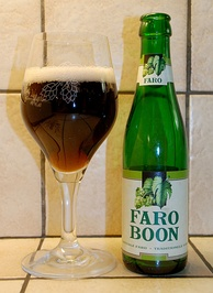 A glass and bottle of Boon Faro