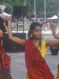 A young Indo-Canadian woman performing Bhangra dancing.
