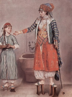 Two 18th century Turkish women, pastel by Jean-Étienne Liotard, who visited Turkey with a British ambassador in 1738. Unlike their baggy trousers, the huge pattens worn by the women would not have struck Europeans as remarkable, as Western women wore similar overshoes.