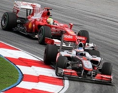 Felipe Massa battling over seventh place with Jenson Button at the Malaysian Grand Prix after starting from 21st position.