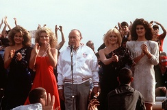 Entertainers during a Christmas Eve USO show in 1983 on board the USS New Jersey (BB-62) off the coast of Beirut, Lebanon. (left to right) Miss USA Julie Hayek, Cathy Lee Crosby, Bob Hope, Ann Jillian and Brooke Shields.