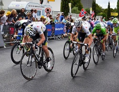 The renowned sprint train of the HTC–Highroad team setting up Mark Cavendish (green jersey) to take victory in stage 11's bunch sprint finish, the third of Cavendish's five stage wins