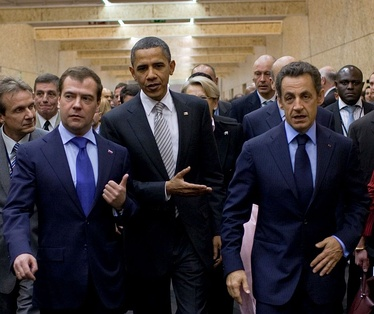 President Obama with Russia's President Dmitry Medvedev (L), and France's President Nicolas Sarkozy (R), at the NATO Leaders Summit in Lisbon, Portugal, November 20, 2010