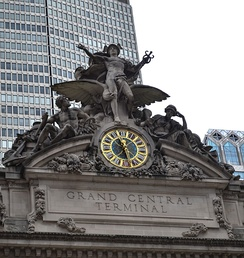 Glory of Commerce, a sculptural group featuring Hercules, Minerva, and Mercury, sits atop Grand Central Terminal in Midtown Manhattan, New York City, one of the ten busiest tourist attractions in the world.[1] In the middle of the grouping is the 13-foot (4.0 m) clock, the world's largest example of Tiffany glass.