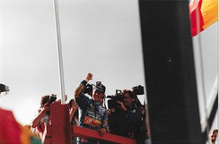 Michael Schumacher celebrating his race win before being disqualified.