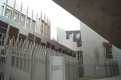 Bilingual signs in English and Gaelic are now part of the architecture in the Scottish Parliament building completed in 2004.