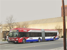 A New Flyer hybrid-electric articulated bus operated by UMass Transit