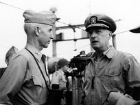 MajGen O.P. Smith (left) and VAdm James H. Doyle, USN,  confer on board USS Mount McKinley (AGC-7), immediately prior to the Inchon Invasion.