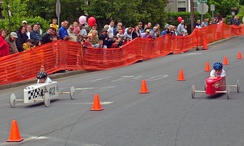 Children racing in a soapbox