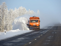 Plowing the road during winter