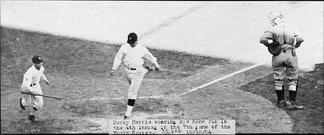 Washington's Bucky Harris scores on his home run in the fourth inning of Game 7 of the 1924 World Series.