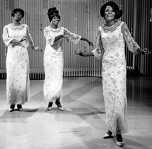 Diana Ross (far right) performing with the Supremes as lead singer