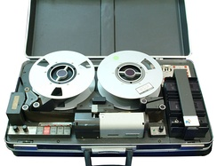 Not all video tape recorders use a cassette to contain the videotape.  Early models of consumer video tape recorders (VTRs), and most professional broadcast analog videotape machines (e.g. 1-inch Type C) use reel to reel tape spools.