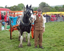 Local resident Kevin Pack, dressed in vintage Yorkshire attire, takes his horse for a turn of the field in front of the crowd at Otley Show.