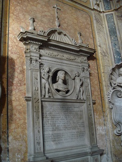 The tomb of Giovanni Battista Milizio de' Cavalieri in Santa Maria in Aracoeli in Rome. Note that the tomb and this portrait bust are not that of the composer Emilio de' Cavalieri. Emilio de' Cavalieri is buried in the chapel, but the tomb itself disappeared during later renovations. In March 2002 a replacement plaque commemorating his burial was placed in the chapel