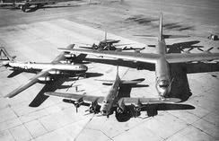 "Special photo of Air Force bombers from the 1930s through the late 1940s. A Douglas B-18 ""Bolo""; a Boeing B-17 ""Flying Fortress""; a Boeing ""B-29 Superfortress"" and the B-36 ""Peacemaker"" dominating the group photo with a 230-foot wingspan. Taken at Carswell AFB after receipt of the first B-36 in 1948. Note the SAC 7th Bombardment Wing marking on the B-29."