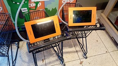 Shopping carts for children fitted with gaming computers.