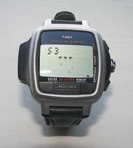 Timex Datalink USB Dress edition from 2003 with a dot matrix display; the Invasion video game is on the screen