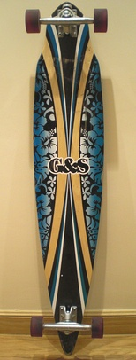 A 44-inch (110 cm) pintail shaped deck