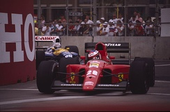 Prost's teammate Jean Alesi is pursued by Riccardo Patrese in the Williams FW14.