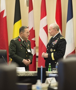 General Erdal Öztürk (left), shown here with U.S. Army Gen. Martin E. Dempsey, right, the chairman of the Joint Chiefs of Staff, has been arrested over reported involvement in a coup attempt.