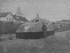 Photograph of an improvised armored vehicle, constructed by the Polish defenders of Lwów, decked with the White Eagle and an American Flag, 1918