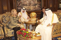 Photograph of Secretary of State Clinton meeting with King Abdullah of Saudi Arabia. She is seated on the left, he is on the right. Their interpreters are in the background.