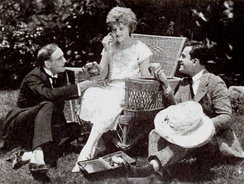 Ramsey Wallace, Miss DuPont (doing her make-up), and Jack Perrin on set in The Rage of Paris (1921)