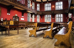 "The Oxford Union debate chamber. Called the ""world's most prestigious debating society"", the Oxford Union has hosted leaders and celebrities.[358]"
