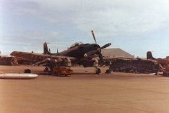 An A-1H Skyraider of the VNAF 516th Fighter Squadron being loaded with napalm at Da Nang Air Base in 1967.