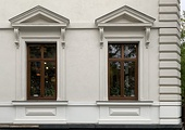 Two windows with pediments on a house from Bucharest (Romania)