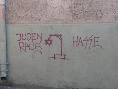 "Antisemitic graffiti in Lithuania. The signs read ""Jews out"" and ""Hate"""